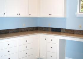 Upstairs laundry/hobby room, with slate floors, silestone counters and apron front sink.