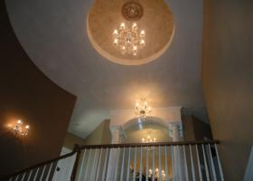 Radius wall and stairs, dome ceiling, rope lighting, custom mirror.