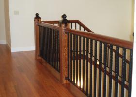 Custom railing featuring both wood and wrought iron and custom iron newel post.