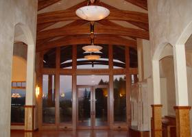 Vaulted beam ceiling with dropped arched glue lam beams clear finish.