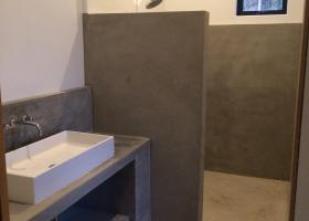 Concrete cabinets, showers and floors.