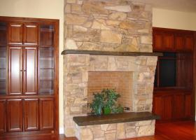 Built in stained wood cabinetry. Hidden full access to media equipment.
