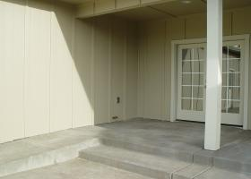 Flush stoop entrance with combinations of stair and wheel access to lower patio and yard.