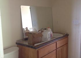 No paint, trim, counter top attached, sink hook up, mirror, damaged sub floor.