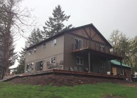Added new and larger windows and locations, fixed siding, paint, gutters and deck.