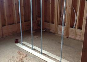 Future concrete wall divider for shower
