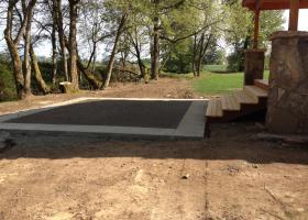 Concrete with boarder trim.